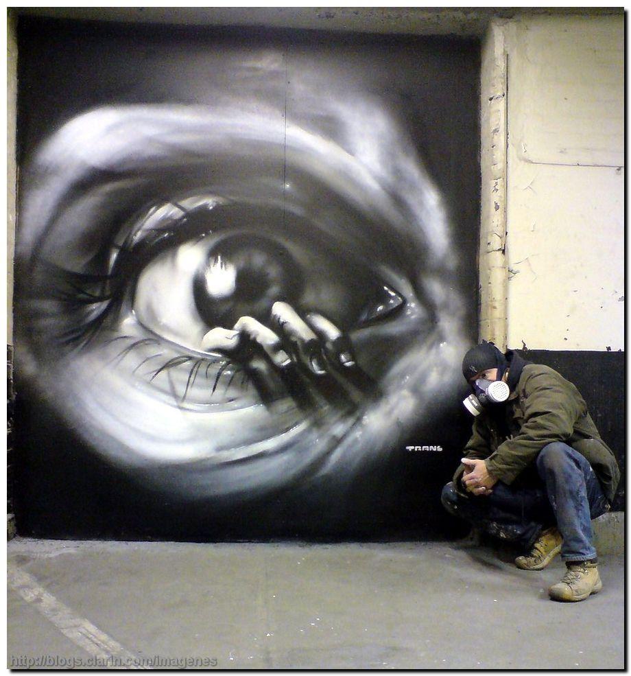Graffitis de Ojos- mano dentro de ojo